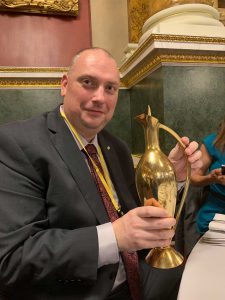 Chris holding a solid gold Claret Jug